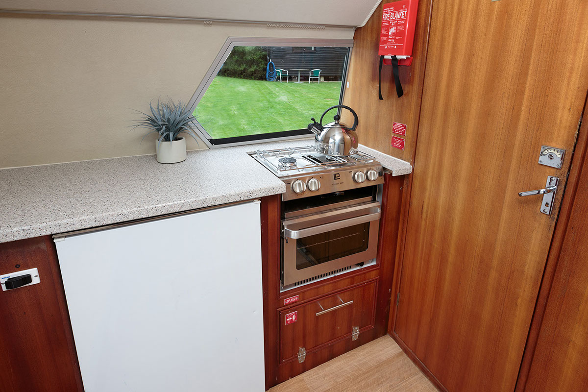 A full size fridge, small hob & oven