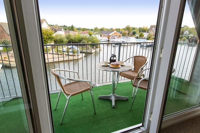 Balcony off lounge with views over Daisy Broad